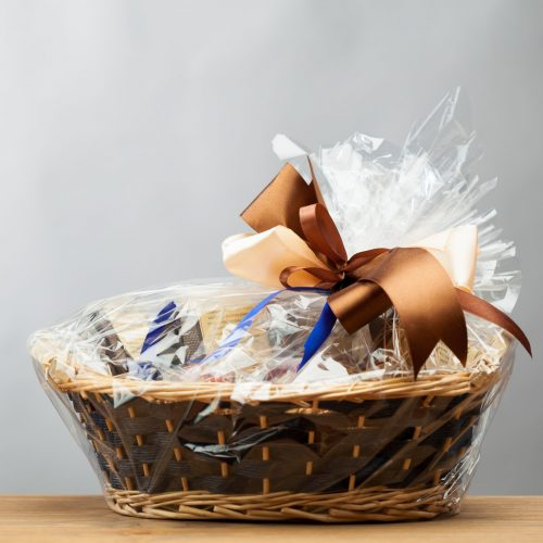 stock-photo-gift-in-a-basket-grey-background-136564220